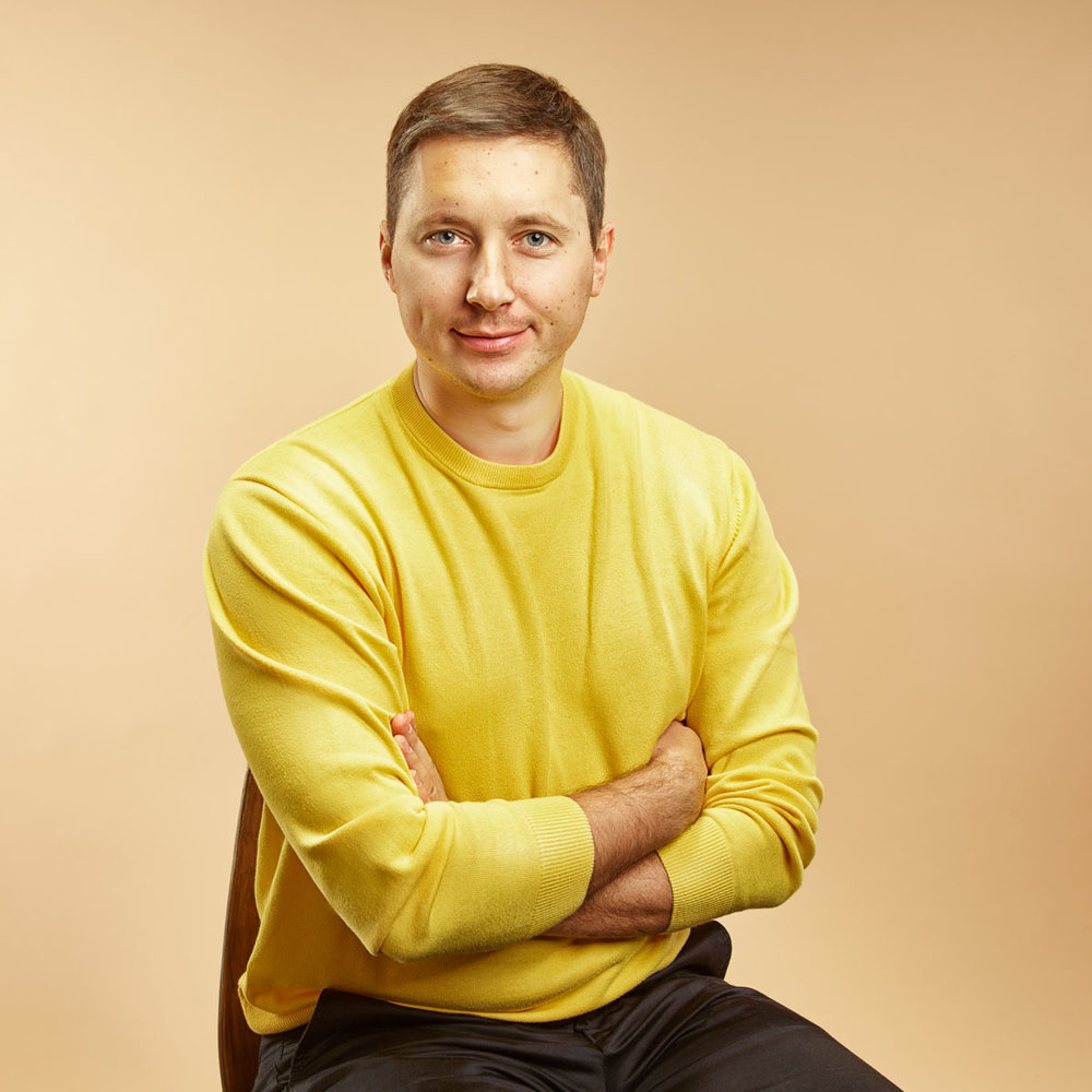Portrait of a young man in  bright sweater.