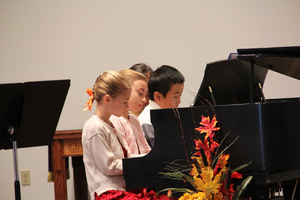 Practice makes perfect! - Masha and Ulyana performing at an Erie Music Teachers Association (EMTA) concert in November