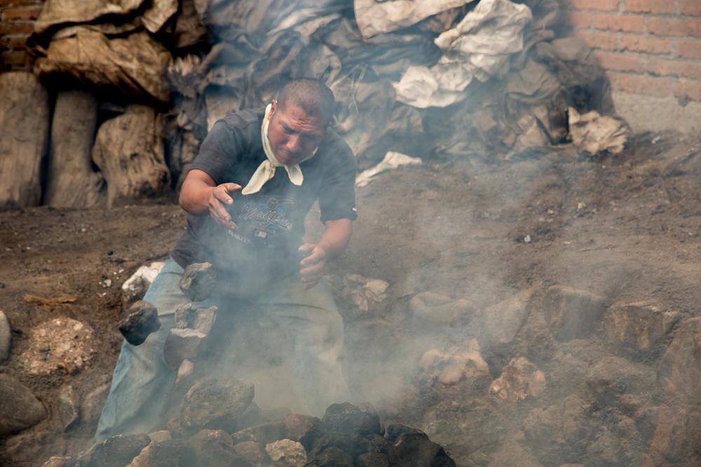 Bombero prepares the pit oven
