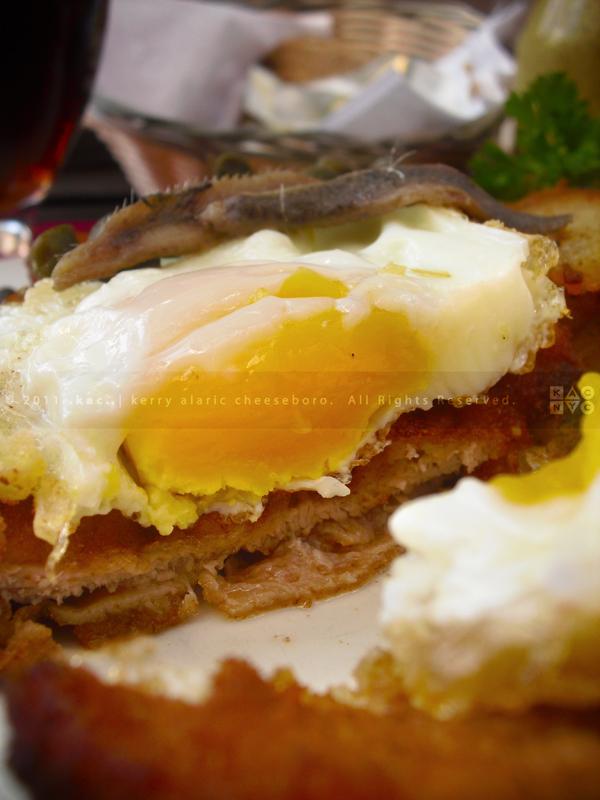 Wiener a la Holstein with Homefries & Red Cabbage