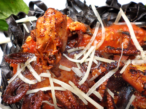Grilled Baby Octopi over Squid Ink Linguine