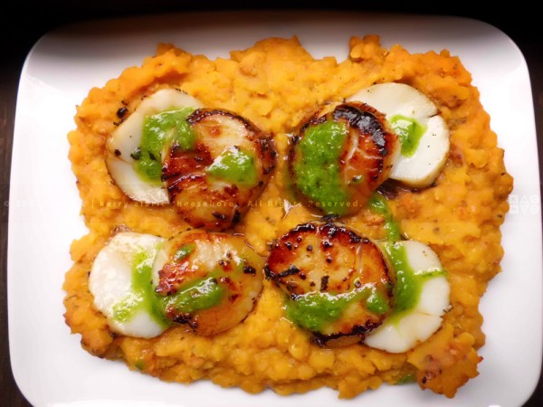 Seared Scallops over Red Lentils with Sausage