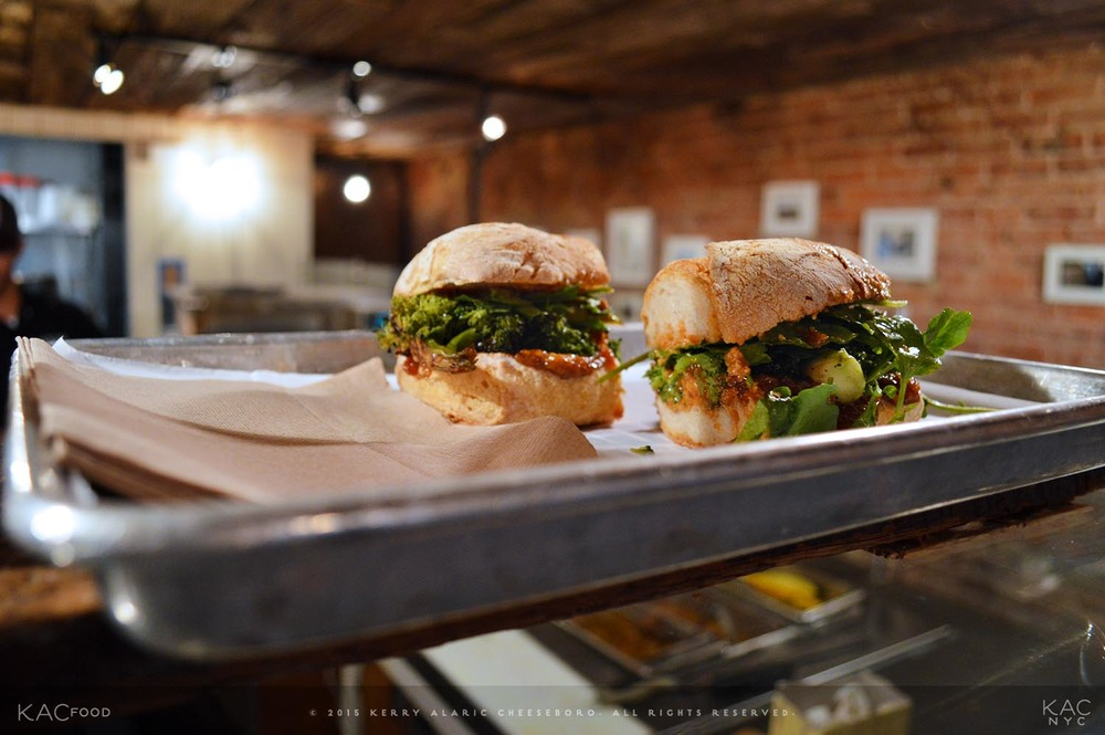 SHEEMAKERS BOUNTY SANDWICH | Charred broccoli, fried almond butter, pickled raisin jelly, cress