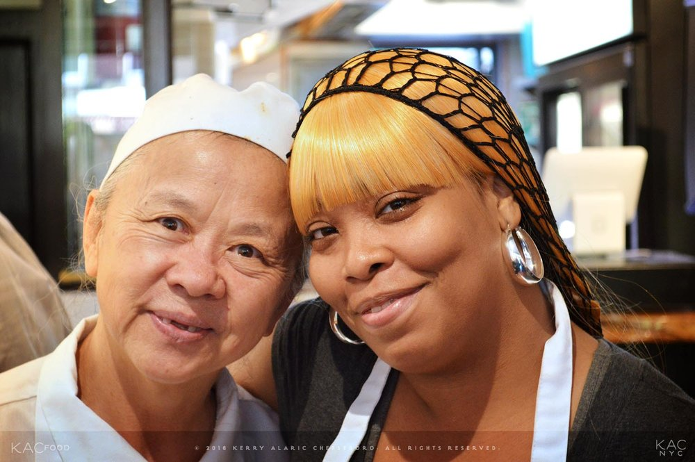 Quihi Guan (left), Co-Owner/Head Chef, with server