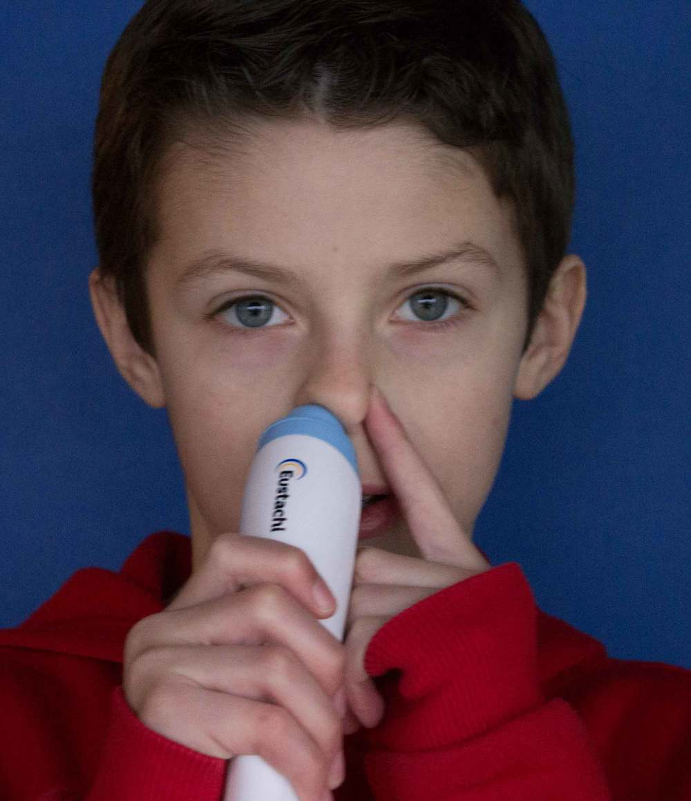 Boy using Eustachi Eustachian Tube exerciser