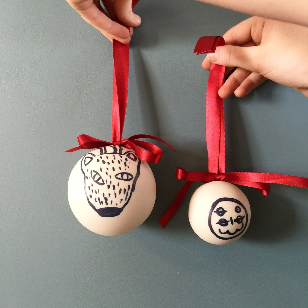 Studio A collaboration with mud australia, 2016,featuring artwork by Phil Sidney (left),Thom Roberts (right) and Meagan Pelham (not pictured)on Christmas baubles to be sold in mud australia stores worldwide.