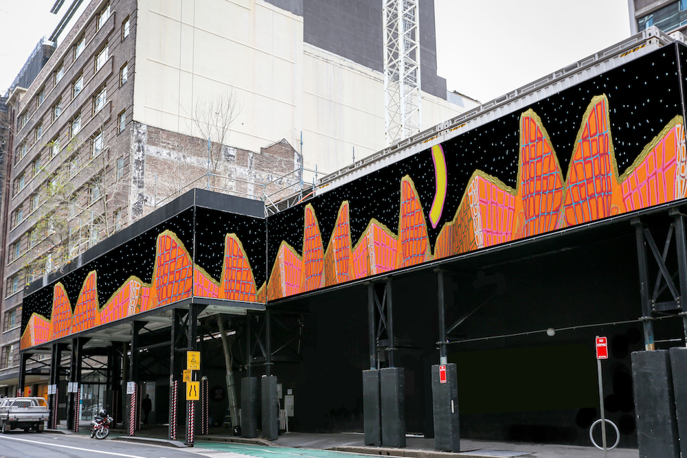 Studio A artist, Emily Crockford's 'Sydney Opera House at Night' on a construction hoarding (mock-up). This artwork was selected by the City of Sydney as a part of their Site Works project: a collection of original contemporary artworks licensed for use on construction sites across Sydney.