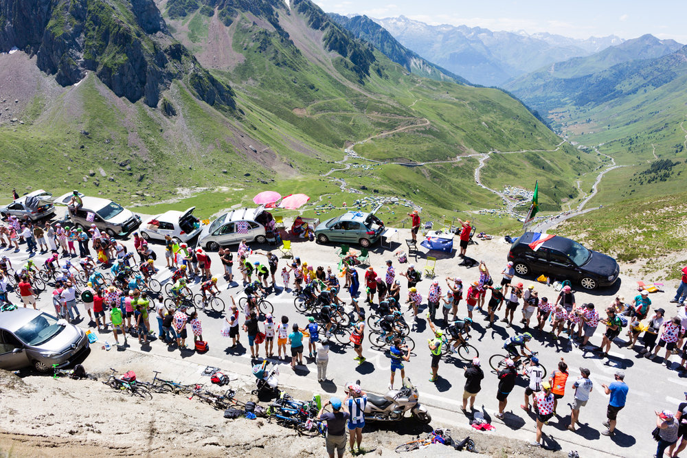 The peloton climbs the Toumalet Pass during the 2016 Tour de France. The alpine passes are filled with fans who wait hours, just to see the cyclists pass in less than 10 minutes.