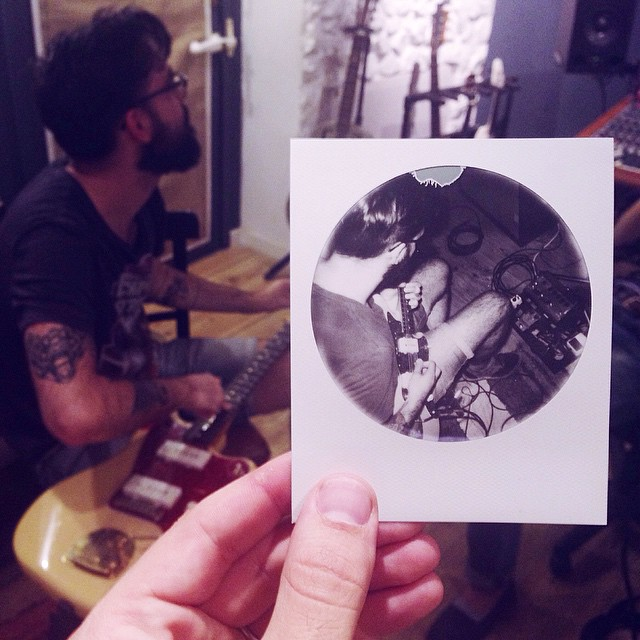 """Polaroid 7 of 16. @gonzalowl fixing a string after his mighty fingers break it in a solo in """"GOLD"""" (at El Invernadero)"""
