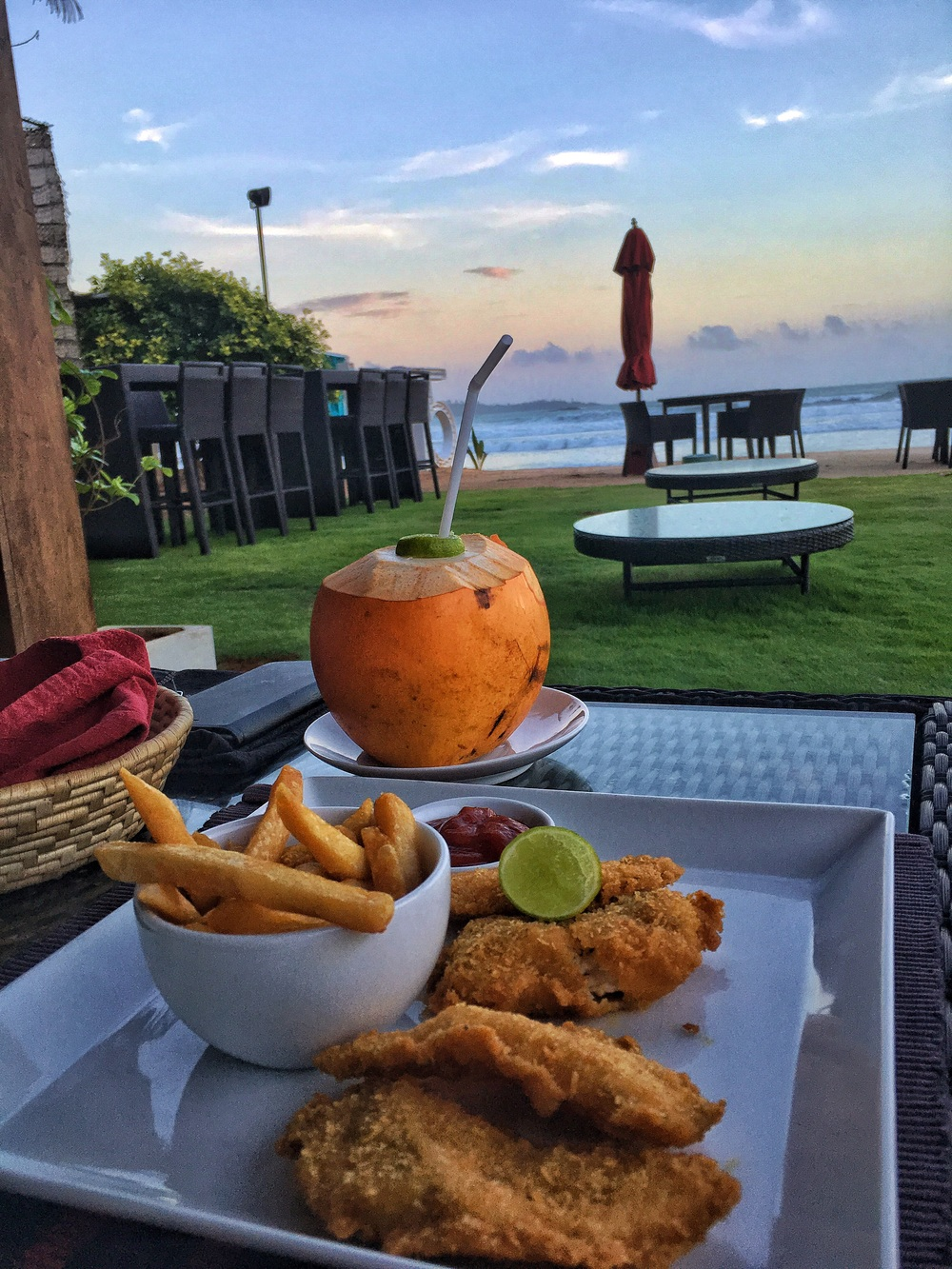 Enjoying the ocean views with some fish and chips and a fresh coconut at W15.