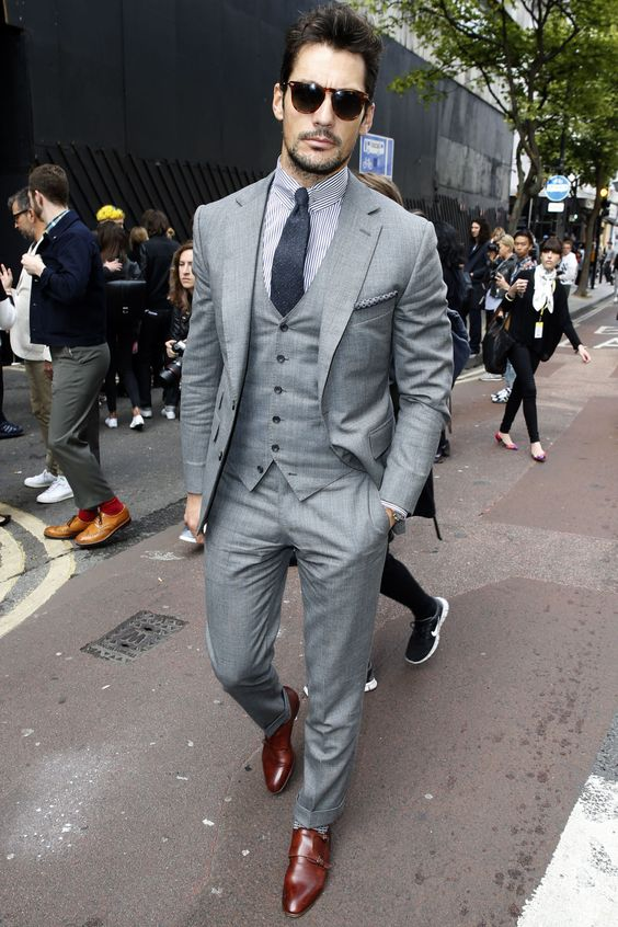 Bearded man in grey three piece suit