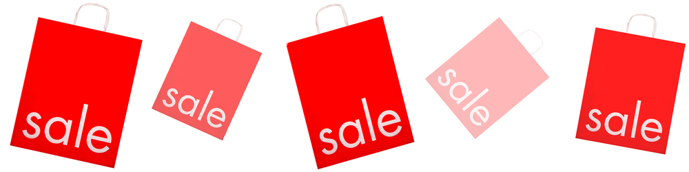Red and white bags with the word sale on them