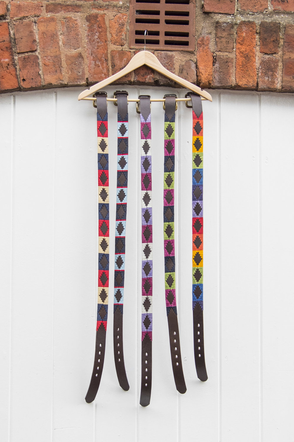 Polo ties hanging off a wall.jpg