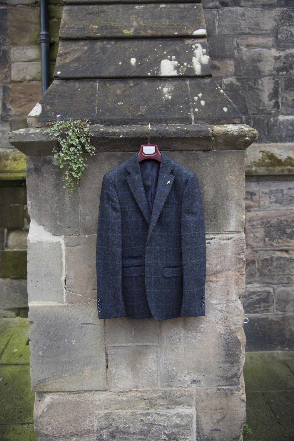 Man's jacket hanging outside a church in Hereford