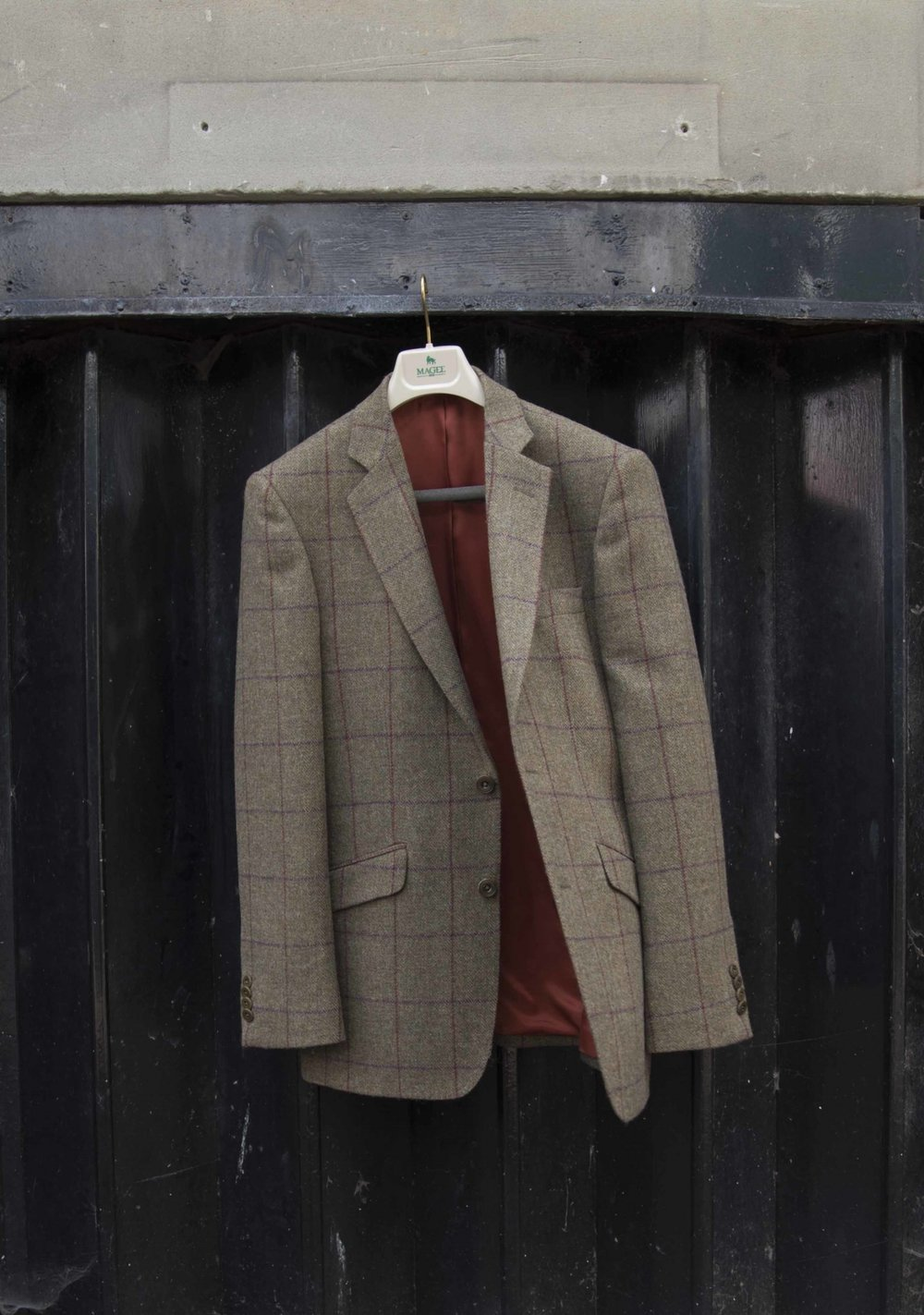 Man's tweed jacket with burnt orange lining