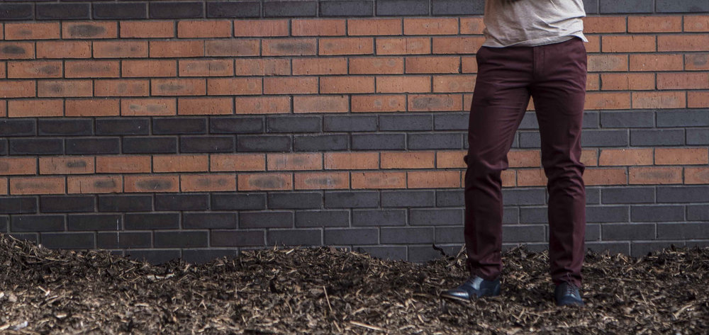 man wearing wine coloured chinos