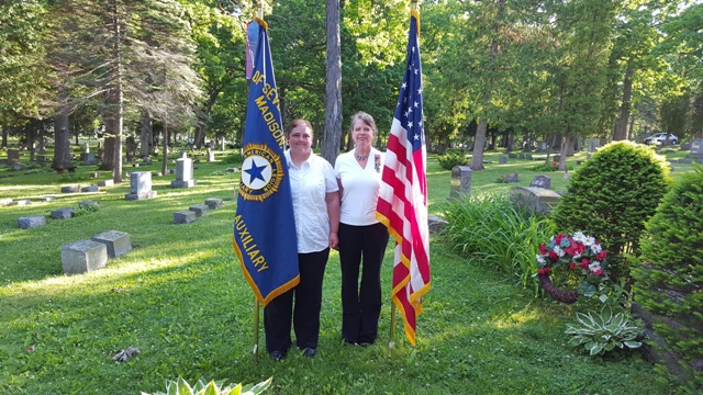 Unit 501 President, Rebecca Lovell, and Diana Jensen carrying flags at Forest Hill Cemetery, Madison, WI, on Memorial Day, May 30, 2016.