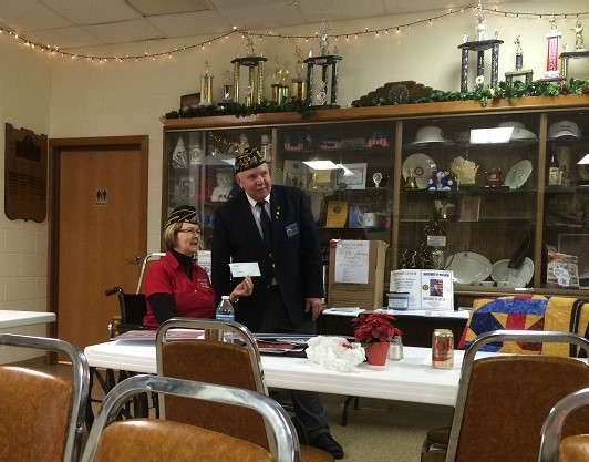 Post Cdr. Tom Stolarczyk presenting to Denise Rohan at the Dane Cty Council Mtg, 12-1-2016, in support of her campaign for American Legion Nat'l Cdr.