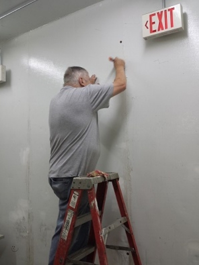 Jerry preparing the Post 501 History/Auxiliary meeting room wall for painting, 6/29/2017.