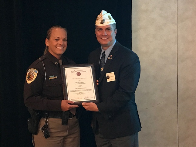 Deputy Longley receiving her citation award from WI American Legion Cdr. Dan Seehafer, 7/15/2017.