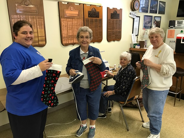 Unit 501 Auxiliary making stockings for the veterans at Middleton VA.  Becky Lovell, Ellie Paulson, Betty Ingwell, Sonia