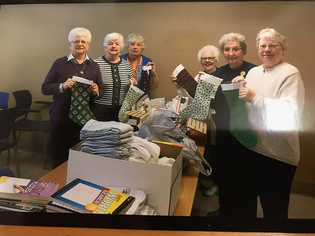 Unit 501 Auxiliary members making & filling stockings for Veterans at Madison VA, December 2017.