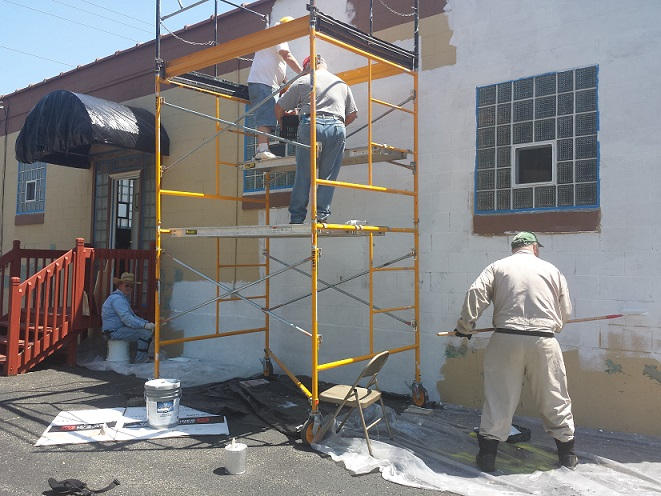 Cdr Thomas Stolarczyk, 1st Vice Cdr Keith Lovell, 2nd Vice Cdr Jerry Schultz, Legionnaire Bill Robbins painting outside of the Legion Post 501 on June 5, 2018.