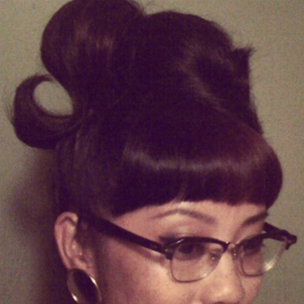 I often change my look from time to time depending on how long my hair is. My favorite hairstyles are big beehive, pinup looking updo's, 40's/50's wingtip liner eye make up, and vintage jewelry and frames.