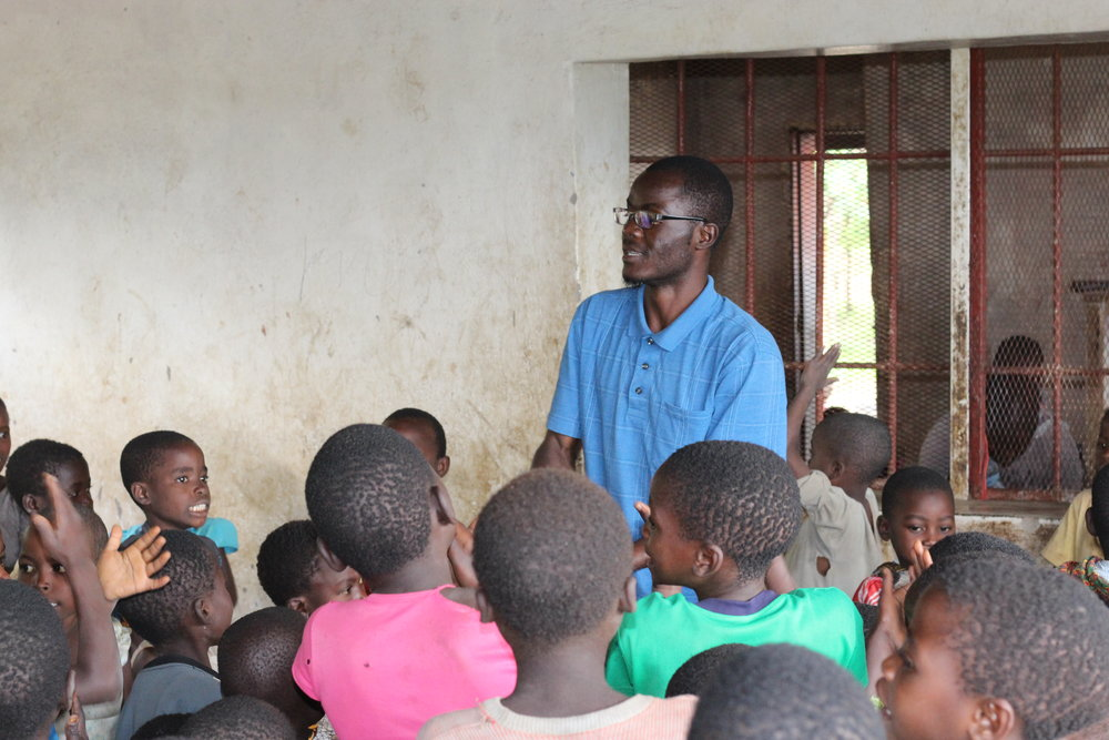 One of our African Bible College students, George, leading the kids' program.