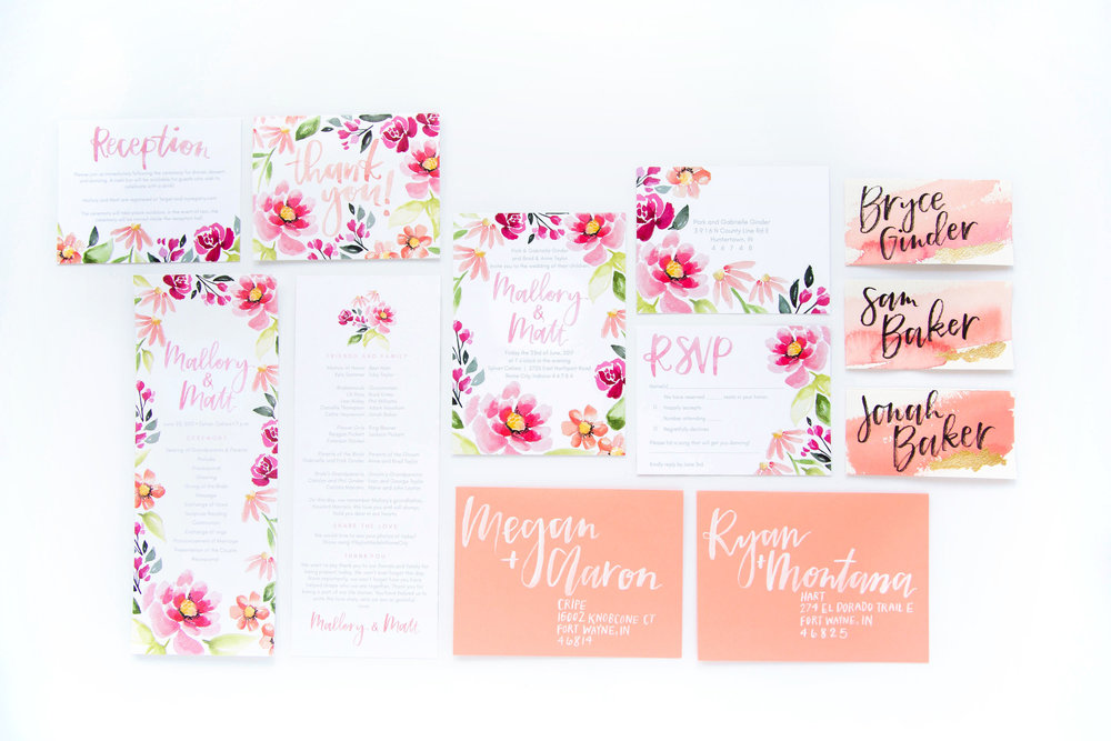 completely custom coral and peach floral wedding stationery and invitation set