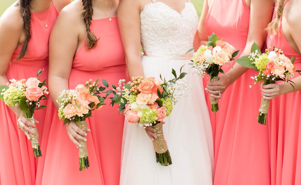 coral bridesmaid dresses with peach, pink, coral, gold, and lime flowers