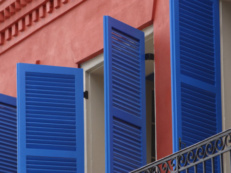 open-blue-window-shutters-on-ornate-building-in-new-orleans-louisiana