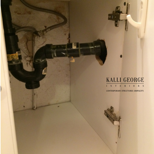 Toronto home bathroom plumbing pipe extending from wall.jpg