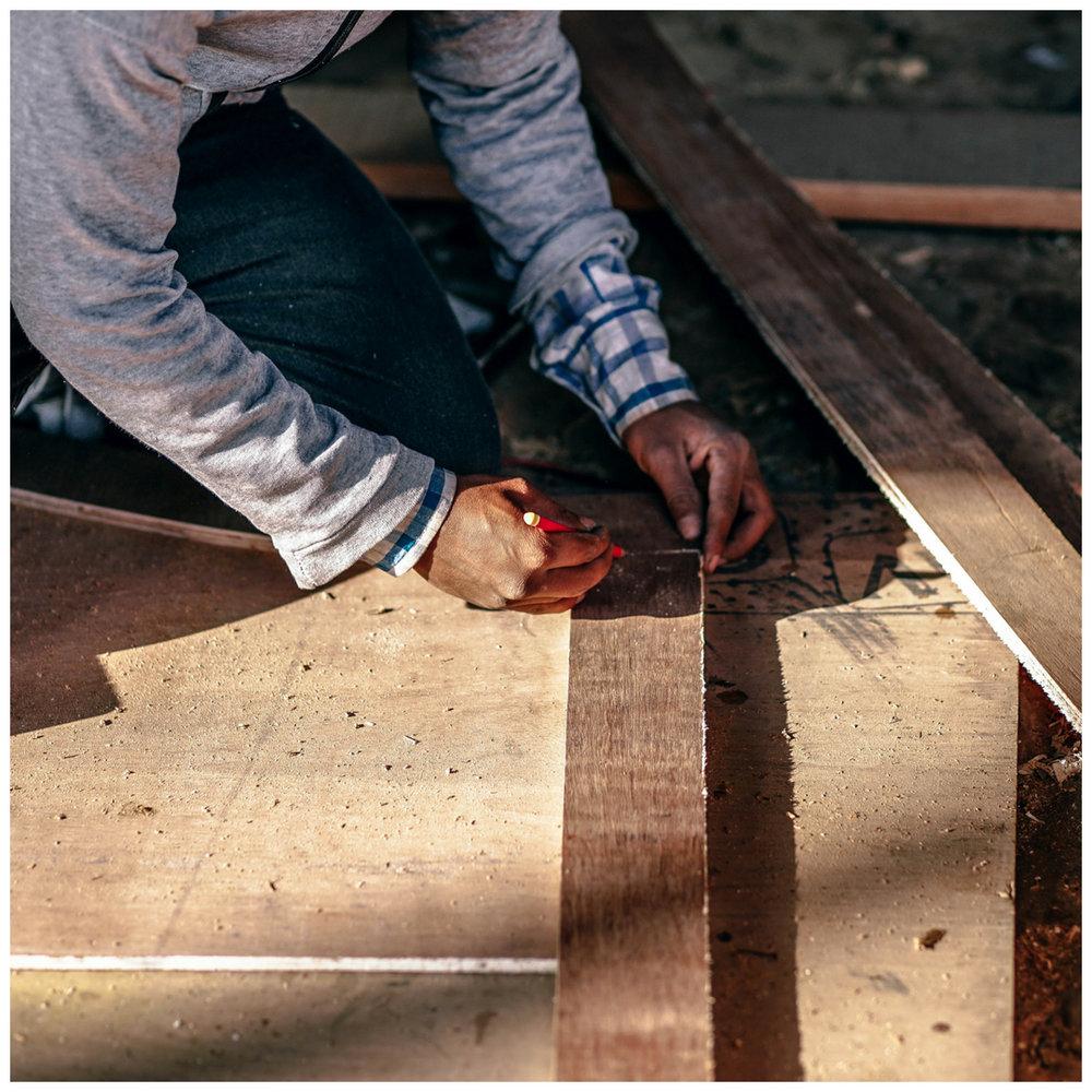 general contractor measuring flooring for install.jpg