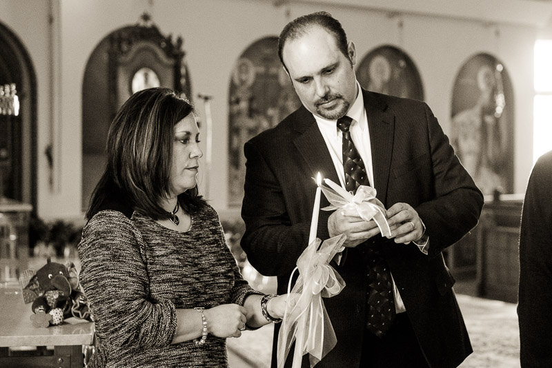 Lighting the Greek Orthodox baptism candles.