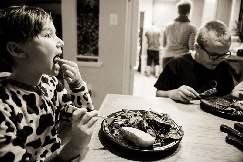 Girl eats her dinner.