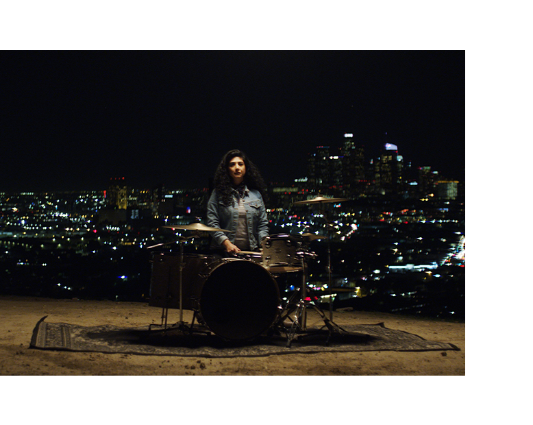 DRUM AS YOU ARE - Director: Jess ColquhounMona Tavakoli is an acclaimed drummer, singer and performer who believes that music can inspire and connect people to a larger purpose. She co-founded and co-directs the Rock n' Roll Camp For Girls Los Angeles, a nonprofit that encourages girls to find their voices through music.