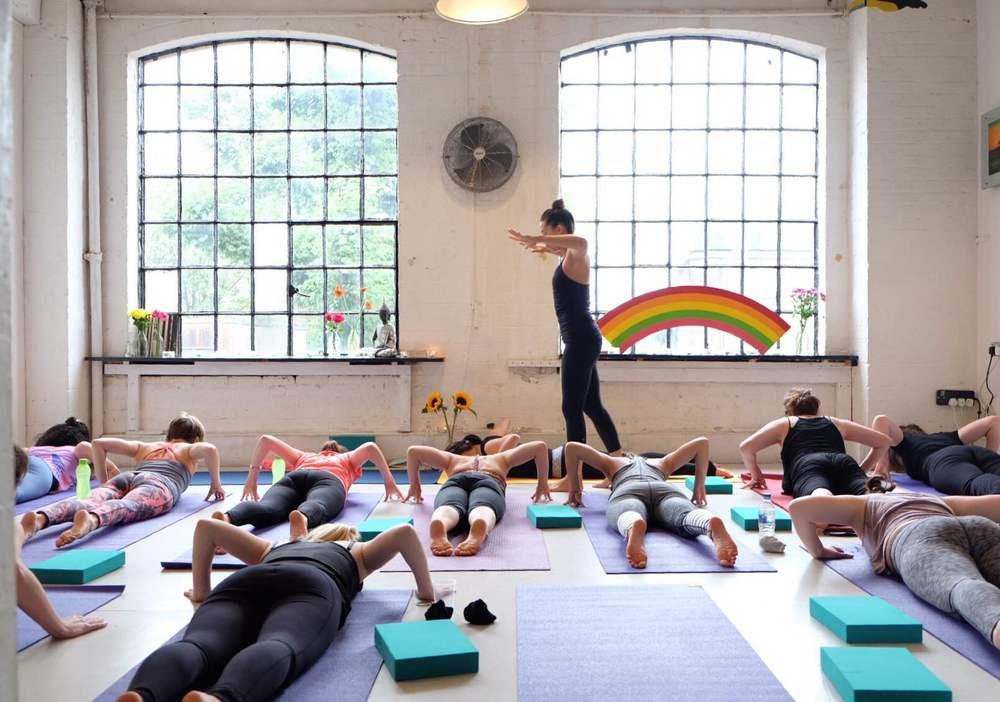 Leyla Rees  teaching some Vinyasa flow yoga for Day Retreats London.