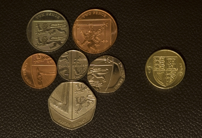 Individual British coins coming together to make the Royal shield of the United Kingdom. Image Credit:  DaveKentUK  via  Flickr   cc
