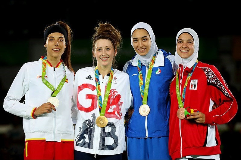 Jade Jones (second from left) alongside her fellow medalists after defending her taekwondo title in the women's 57kg. Image Source:  Mohammad Hassanzadeh/Tasnim News Agency  via  Wikimedia Commons   CC