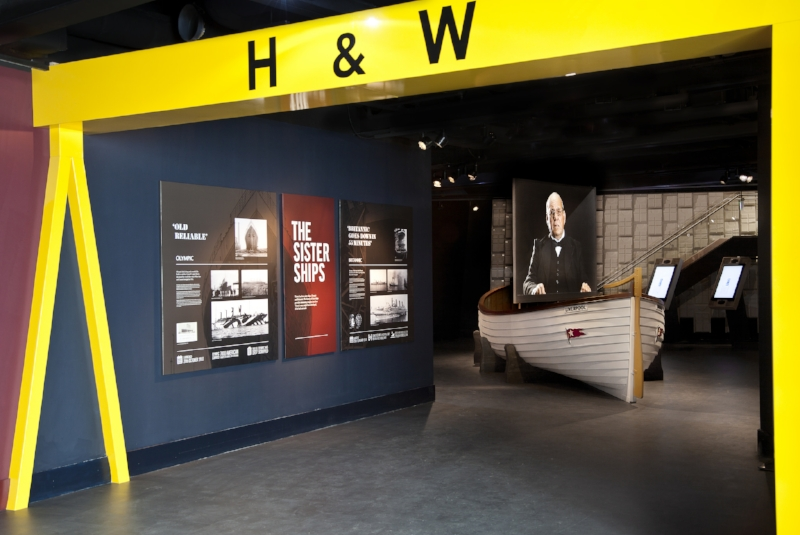 The Aftermath Gallery featuring a replica lifeboat and representation of the present-day Harland and Wolff gantry cranes. Image Credit:  Titanic Belfast  via  Flickr   CC