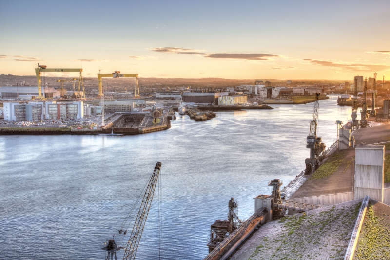 Grand View of the River Lagan, Belfast Harbour, the city itself and beyond. At Left are the gantry cranes of Harland & Wolff,  Samson  and  Goliath ; below them is the Thompson Graving Dock, were  Titanic  was partly fitted out; to the right is Titanic Studios in the large brown building, and further over is Titanic Belfast and the slipways. Image Credit:  Titanic Belfast  via  Flickr   cc