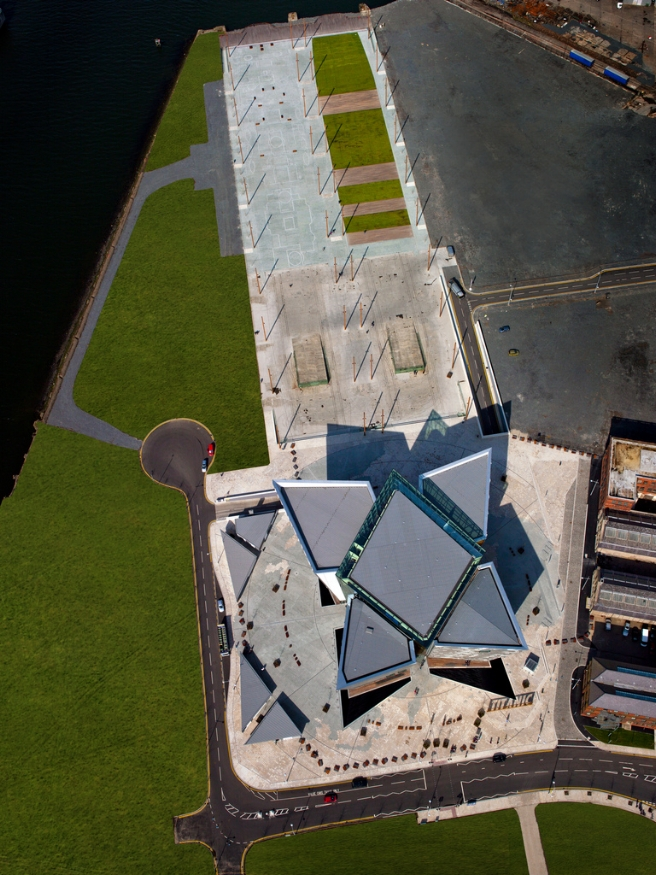 Aerial view of Titanic Belfast, with the slipways ( Olympic's  on the right and  Titanic's  on the left) above it and the Drawing Offices to the Right. Image Credit:  Titanic Belfast  via  Flickr   CC