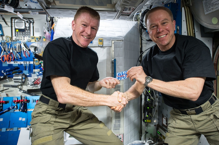 The two Tim's - Britain's Peake and America's Kopra. Major Peake is being given a patch by Colonel Kopra to commemorate his 100th day in space on March 24, 2016. Image Credit:  NASA  via  Flickr  (Public Domain)   - ISS047-E-017191
