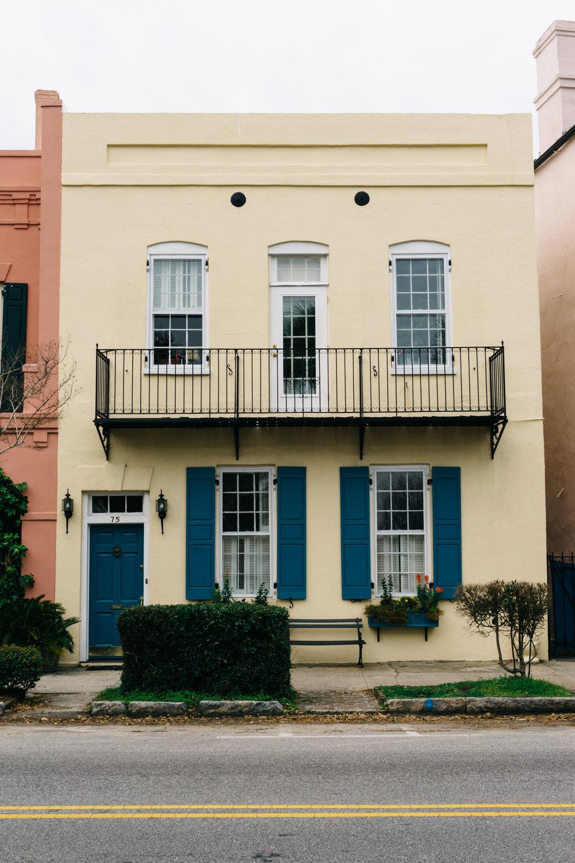 Yellow House with Blue Shutters on Rainbow Row Charleston