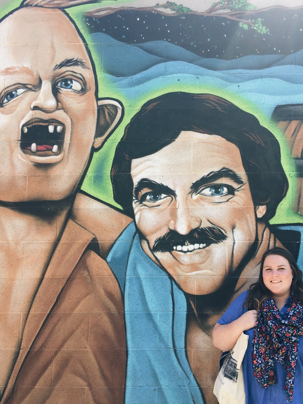 Sloth and Tom Selleck mural at Burial Beer Co.