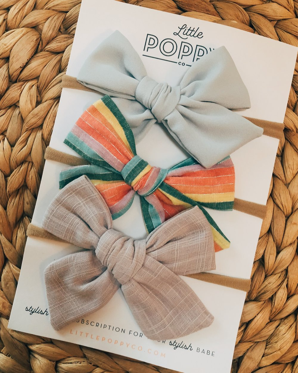 Baby's 1st subscription! These Little Poppy Co. bows came in this week and I have a feeling the blue one will match Rooney's Easter outfit perfectly.