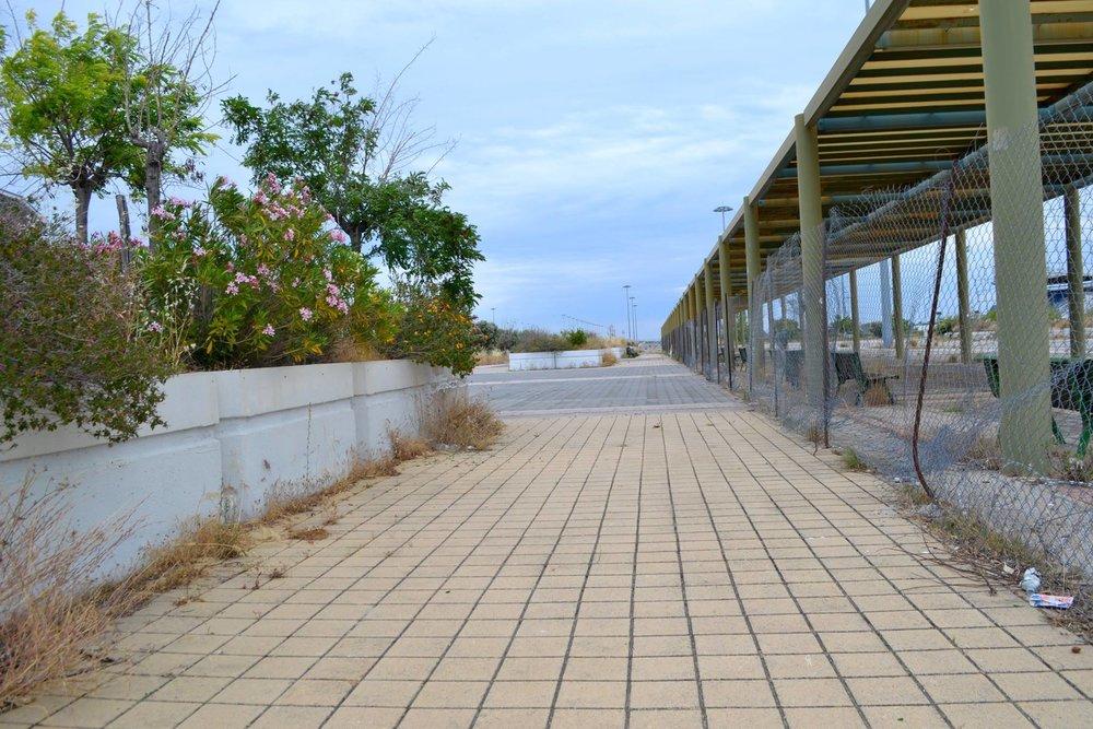"Photo: ""Follow the Yellow Brick Road,"" Elliniko Refugee Camp, Greece. Melanie McCarthy"