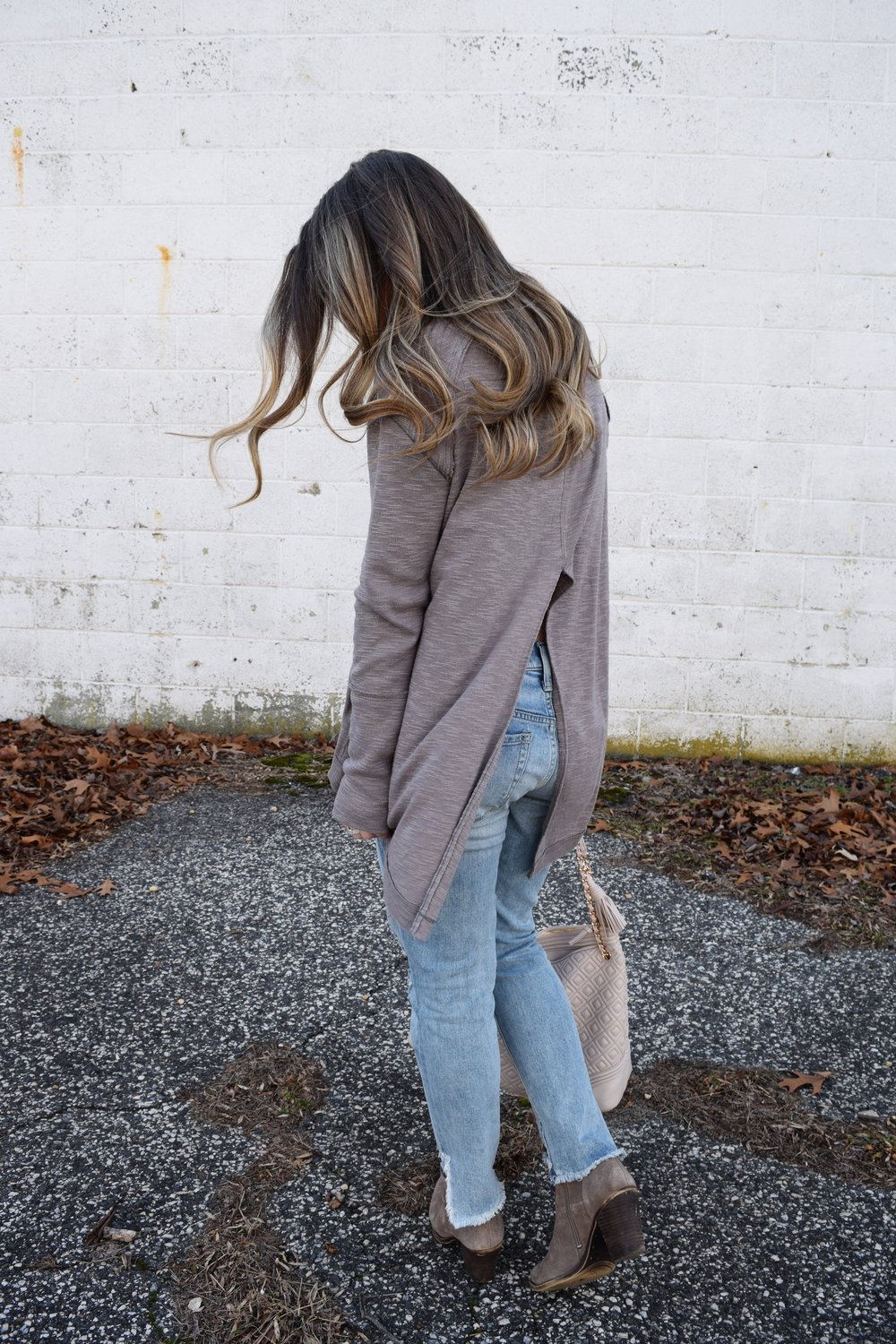 winter fashion, split back turtleneck, distressed denim