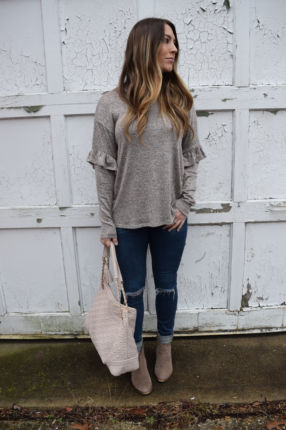 ruffle sleeve top + distressed denim + booties